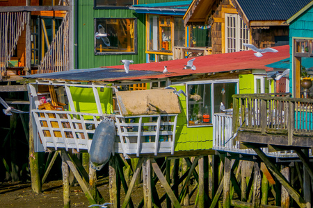 Beautiful coorful houses on stilts palafitos in Castro, Chiloe Island Stock Photo