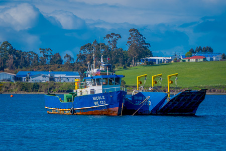 CHILOE, CHILE - SEPTEMBER, 27, 2018: Outdoor view of boats in a port of Ancud, Chiloe island
