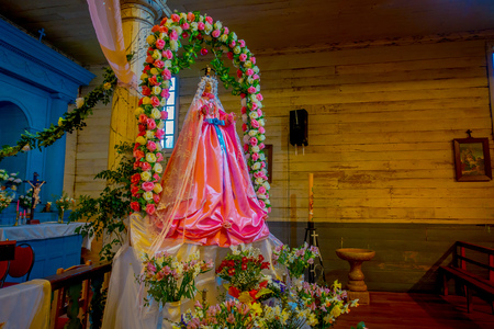 CHILOE, CHILE - SEPTEMBER, 27, 2018: Indoor view of virgin structure inside of church in Nercon, recognized as a World Heritage Site by Unesco