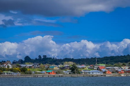 Beautiful outdoor view of buildings in the horizont of Chacao in Chilean mainland in a gorgeous sunny day. Stock Photo