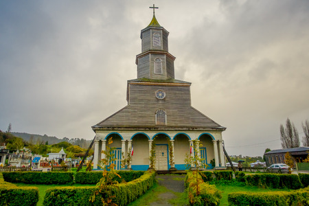 CHILOE, CHILE - SEPTEMBER, 27, 2018: Outdoor view of historic church of Nercon, catholic temple located in the chilota commune of Castro, recognized as a World Heritage Site by Unesco