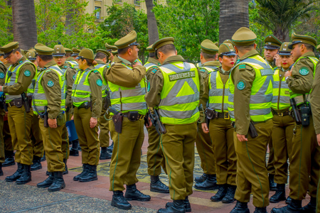 SANTIAGO, CHILE - SEPTEMBER 13, 2018: Outdoor view of crowd of Police called as carabineros in the line ready to check the crowd for segurity in Santiago 写真素材 - 120106613