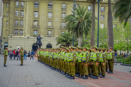 SANTIAGO, CHILE - SEPTEMBER 13, 2018: Outdoor view of crowd of Police called as carabineros in the line ready to check the crowd for segurity in Santiago