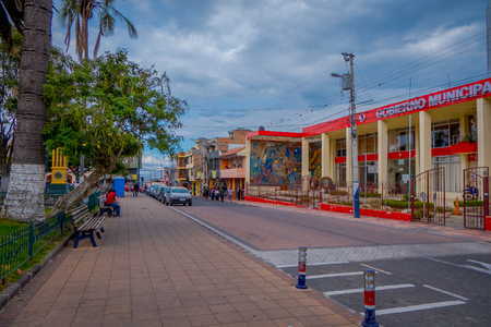 COTACACHI, ECUADOR, NOVEMBER 06, 2018: Outdoor view of municipal red building, located in the city of Cotacachi Editorial