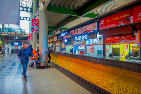 SANTIAGO, CHILE - OCTOBER 09, 2018: Unidentified people waiting inside of the terminal platforms at Alameda bus station. This is the largest and primary bus terminal of the city