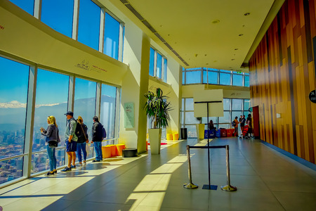 SANTIAGO, CHILE - OCTOBER 16, 2018: Indoor view of unidentified people enjoying the view at Costanera Center Skyscraper Observation Deck Interior
