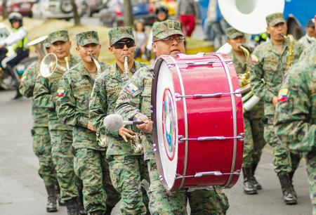 Quito, Ecuador - September, 03, 2018: Unidentified people wearing military uniform in national military parade and playing the drums during the diablada festival Editorial