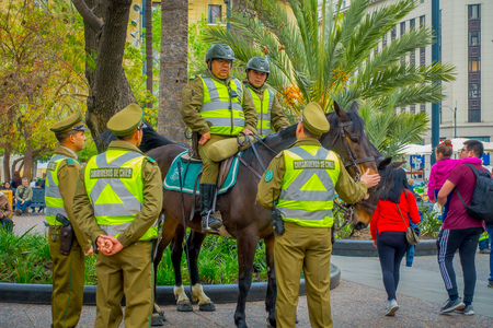 SANTIAGO, CHILE - SEPTEMBER 13, 2018: Outdoor view of Police called as carabineros riding a horse in dowtown of the city of Santiago of Chile