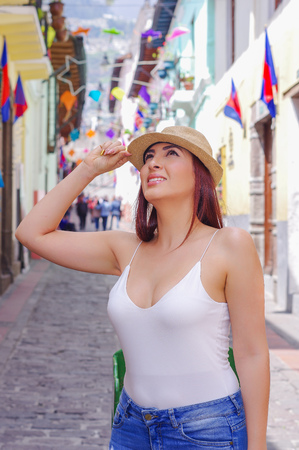 Beautiful young woman at historical center of old town Quito in northern Ecuador in the Andes mountains