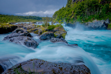 Gorgeous view of water passing through volcanic rock creating waterfalls, formed by an eruption of volcano Osorno in the south of Chile Stock Photo