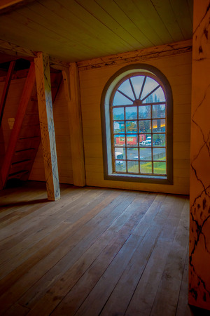 CHILOE, CHILE - SEPTEMBER, 27, 2018: Indoor view of historic church of Nercon, with a gorgeous mitral windows in catholic temple located in the chilota commune southern Chile, World Heritage by Unesco