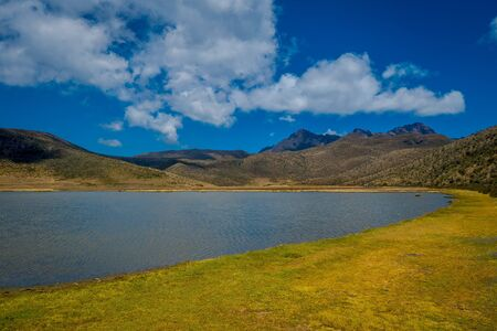 Shore of the lake Limpiopungo located in Cotopaxi national park, Ecuador in a sunny and windy day. Stok Fotoğraf