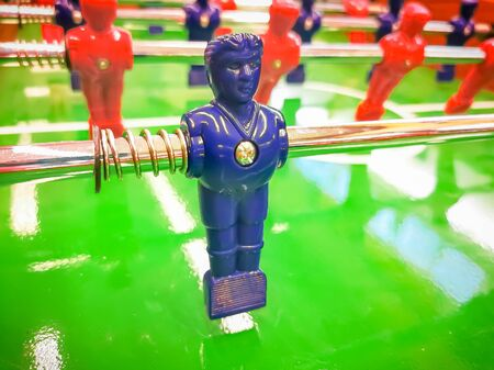 Foosball. Table with red and blue players detail perspective. 版權商用圖片