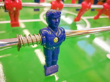 Foosball. Table with red and blue players detail perspective. Imagens