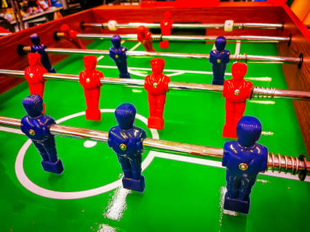 Foosball. Table with red and blue players detail perspective