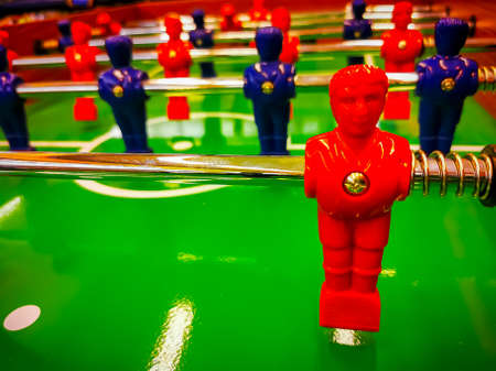 Foosball. Table with red and blue players detail perspective. Banque d'images