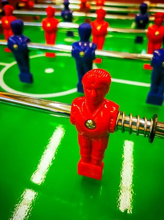 Foosball. Table with red and blue players detail perspective. Stock Photo
