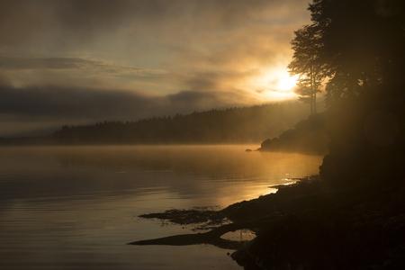 Morning view on foggy Shaori Lake at sunrise Georgia country Stock Photo