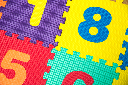 Colorful Baby Mat. Rubber foam pad for children playing. Colorful background ackground with digits Stock Photo