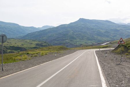 Mountain road. Shemakha mountain road in mountains. Cloudy sky with mountain road of Azerbaijan. Caucasus.