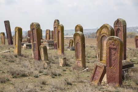 Ancient muslim cemetery near Agstafa, Azerbaijan with writings on farsi for graphic and web design, for website or mobile app Фото со стока
