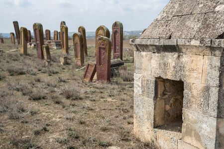 Ancient muslim cemetery near Agstafa, Azerbaijan with writings on farsi for graphic and web design, for website or mobile app