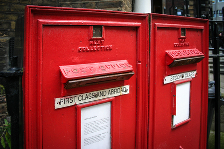 A pair of outdated old English post boxes in a residential area of central London  photo