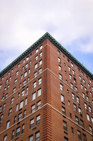 typical: Low angle view looking up at the corner of a typical Manhattan apartment block