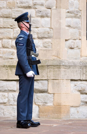 sentry: A sentry guard from the Royal Air Force  RAF  regiment on guard outside his London base