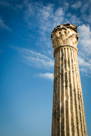offset angle: Low angle view of an ancient Roman column offset against a bright blue sky with copy space  Stock Photo