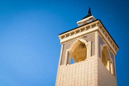prayer tower: Looking up at a traditional minaret tower, a distinctive architectural feature of mosques