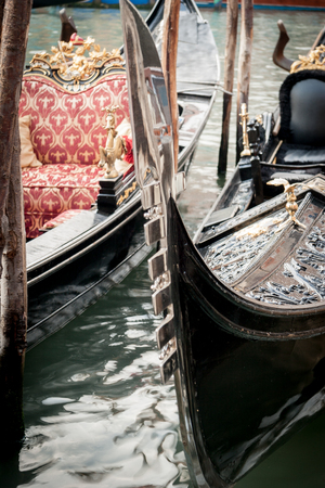 prow: Detail of the prow of traditional gondolas from Venice, Italy.
