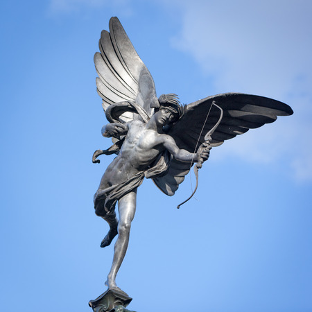 piccadilly: A low angle view of the familiar statue of Eros in Piccadilly Circus, London.