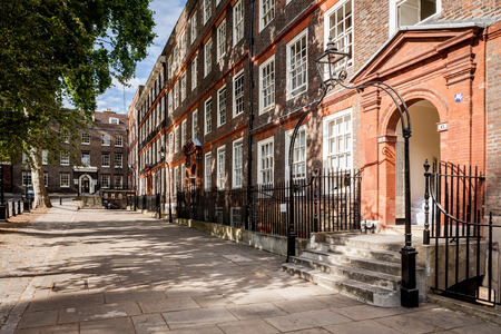 dickensian: LONDON, UK - AUGUST 8, 2006: A view along Kings Bench Walk, a street in the Temple district of London known as the legal district with barristers chambers in traditional old London town houses. Editorial