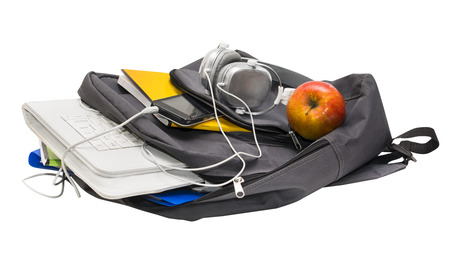 School backpack with school supplies and a tablet with headphones. Notebooks, tablet, headphones, ruler, book, cell phone, apple. photo