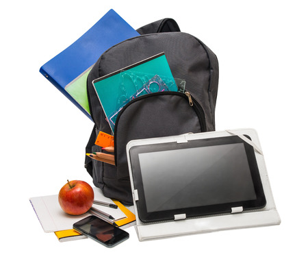 Backpack with school supplies and a tablet computer. Notebooks, tablet computer, cell phone, ruler, apple. photo