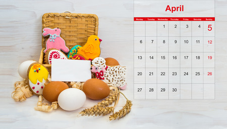 easter cookie: Easter cookie chicken, bunny, little ram in a basket and chicken egg on wooden background