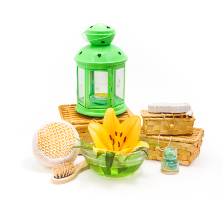 flower boxes: Spa concept.Yellow lily flower, boxes, sea salt, and objects for spa procedures on a white background