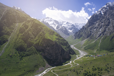 green valley of the Caucasus Mountains in summer