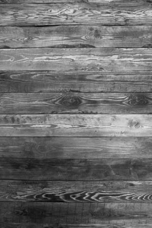 Wall of boards with nails. Twigs, wall texture