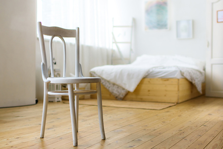 White chair in the bedroom Stock Photo