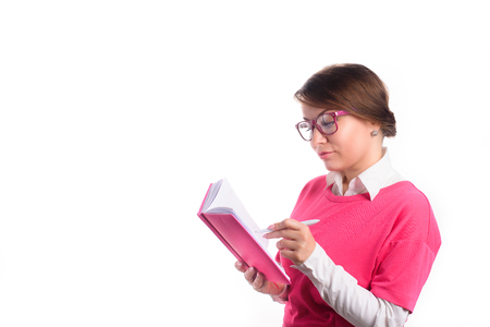 Business woman with a diary writes in a diary Stock Photo