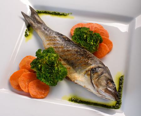 grilled fish on the ceramic plate Stock Photo