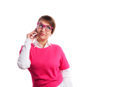 Woman in pink calling by phone