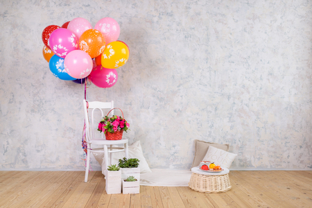 Chair and balloons, flowers basket and cake