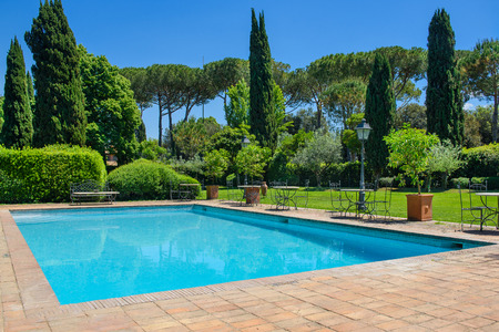 Swimming pool and cypresses, the villa