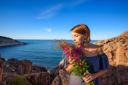 girl holding a willow-herb bouquet Stock Photo