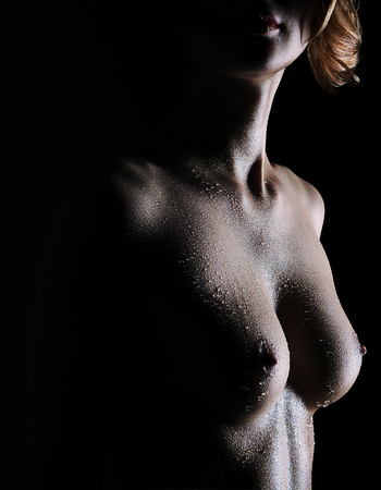 erotic silhouette of a woman water oil Stockfoto