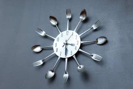 clock in the kitchen, cutlery gray