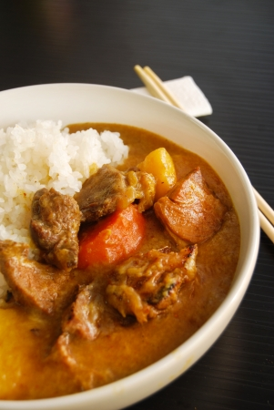 Japanese style curry rice, black table photo